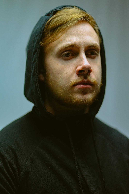 man in black pullover hoodie