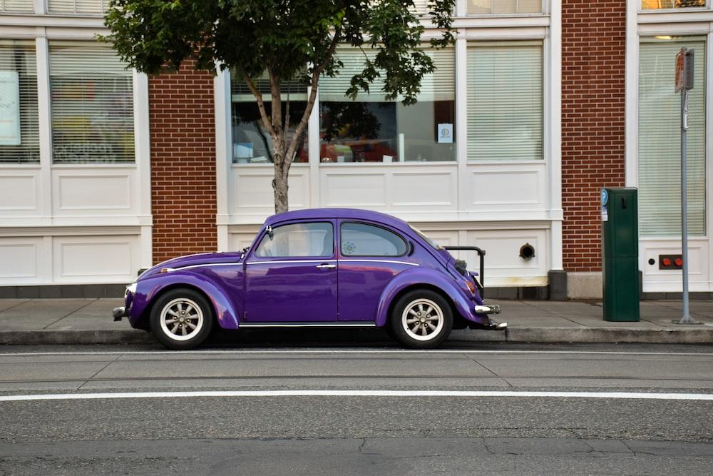 purple 3-door hatchback parked on street