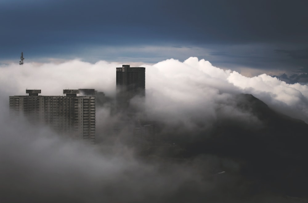 buildings covered by clouds