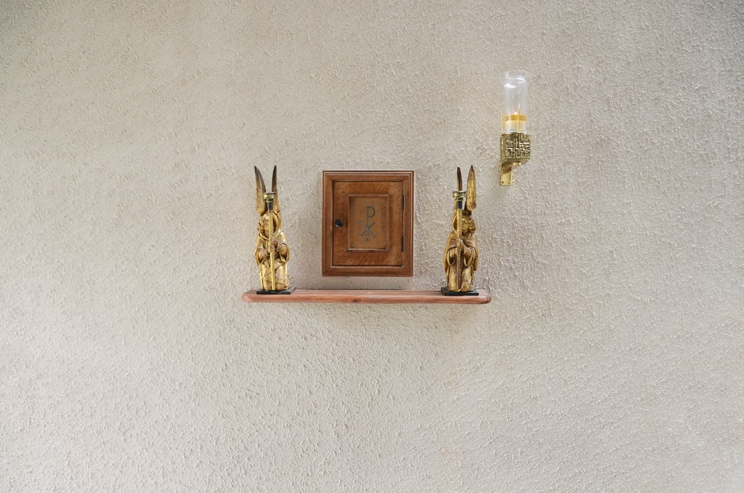 In a 1960s church on the Mackworth Estate in Derby, there is this small Ambry for storing consecrated elements from the Eucharist. It is located on the back wall near the alter.