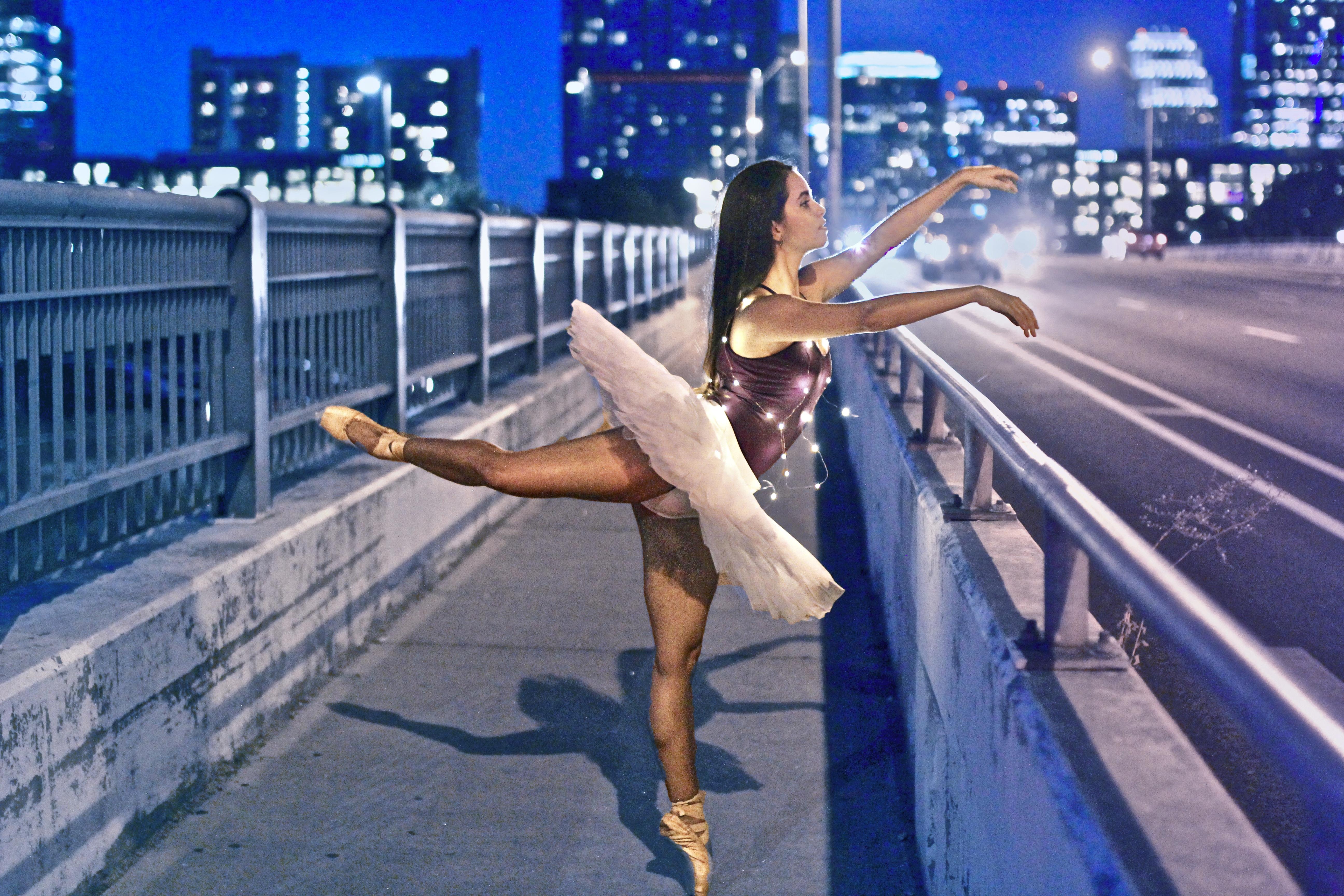 woman wearing ballet dress at roadside dancing