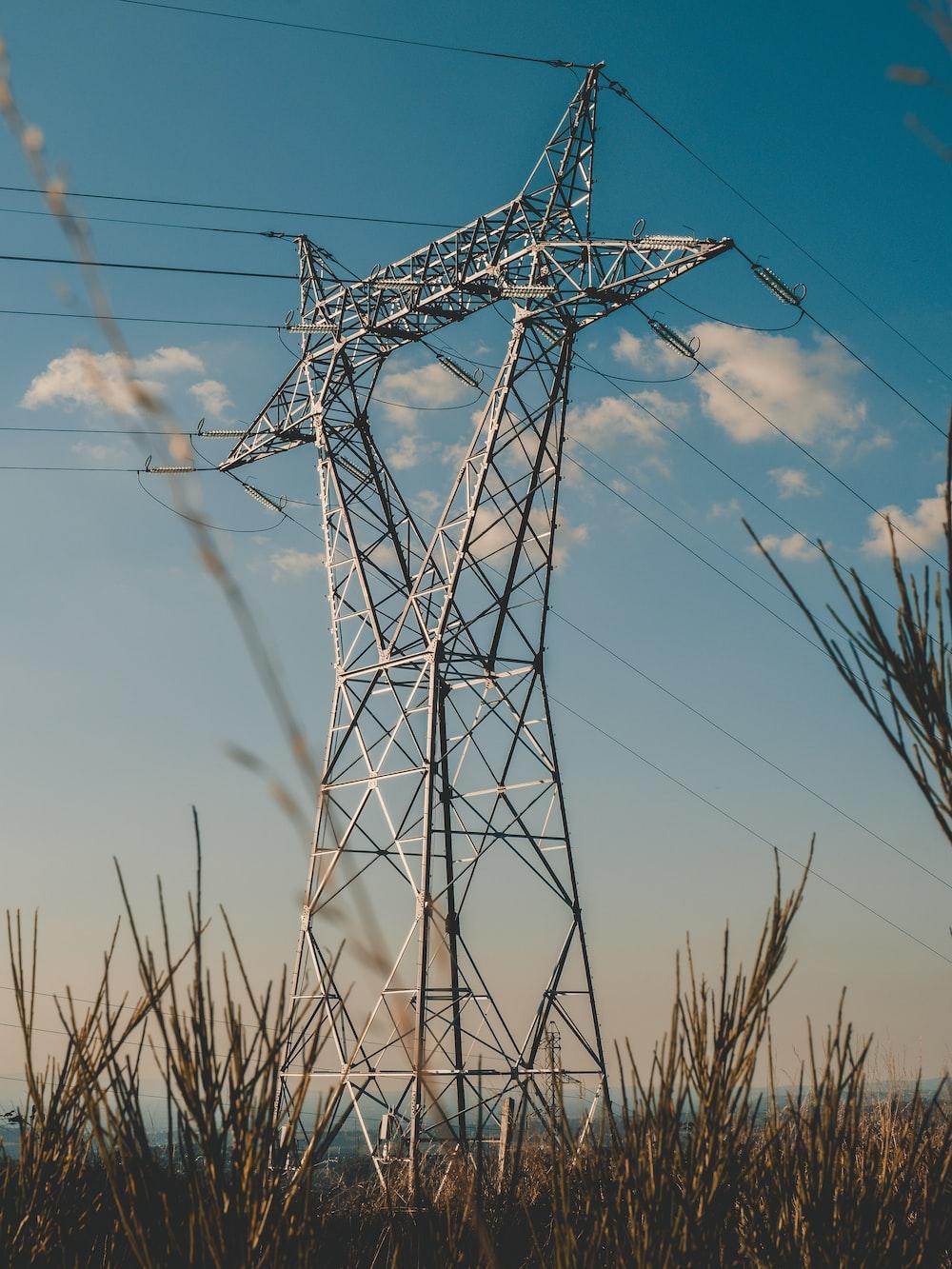 gray power line under blue sky