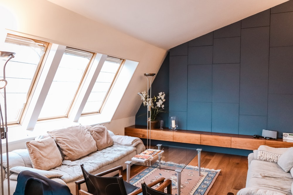 beige 3-seat sofa near the window