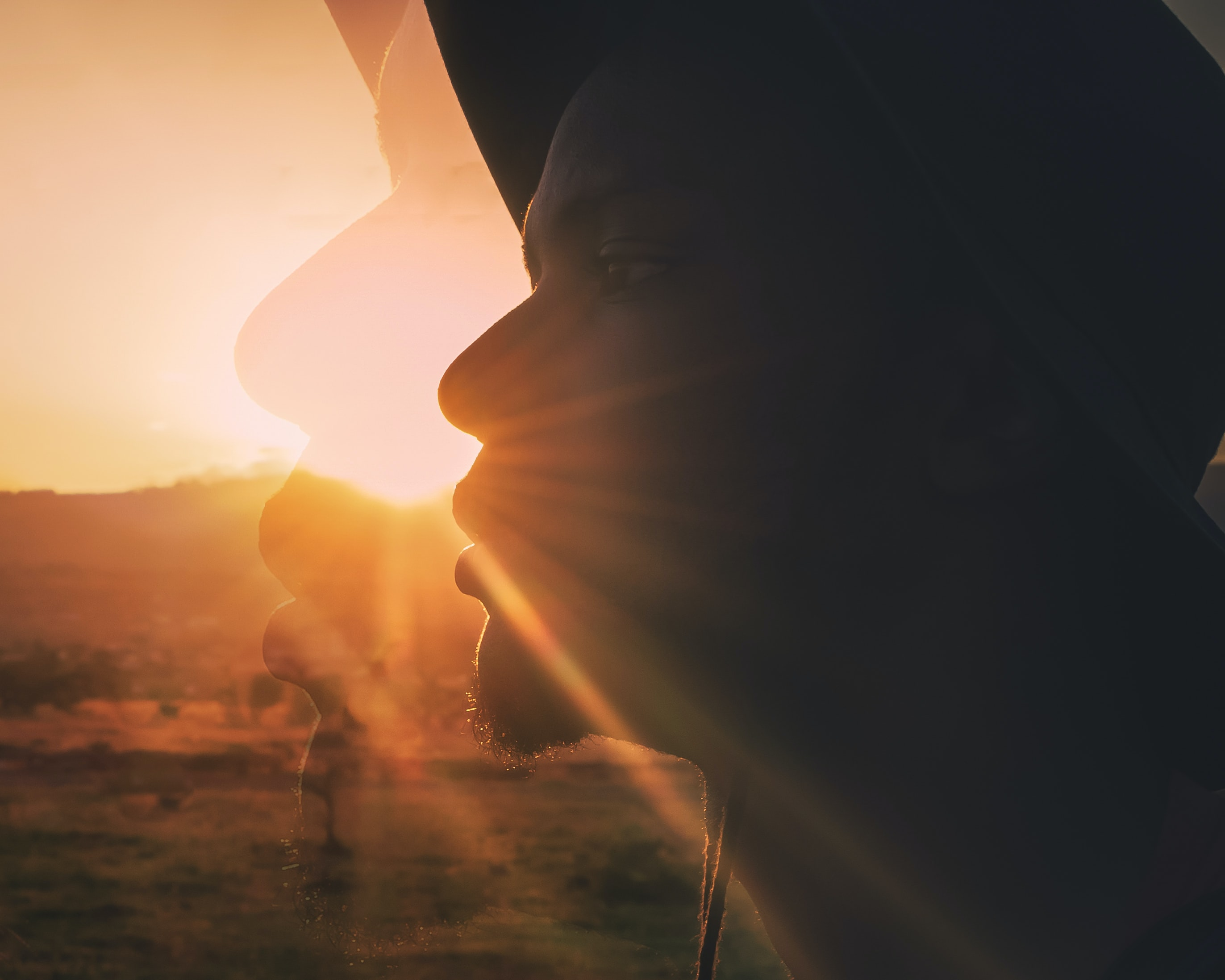 silhouette of person's face during golden hour