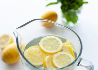slices of lemons in clear pitcher filled with water