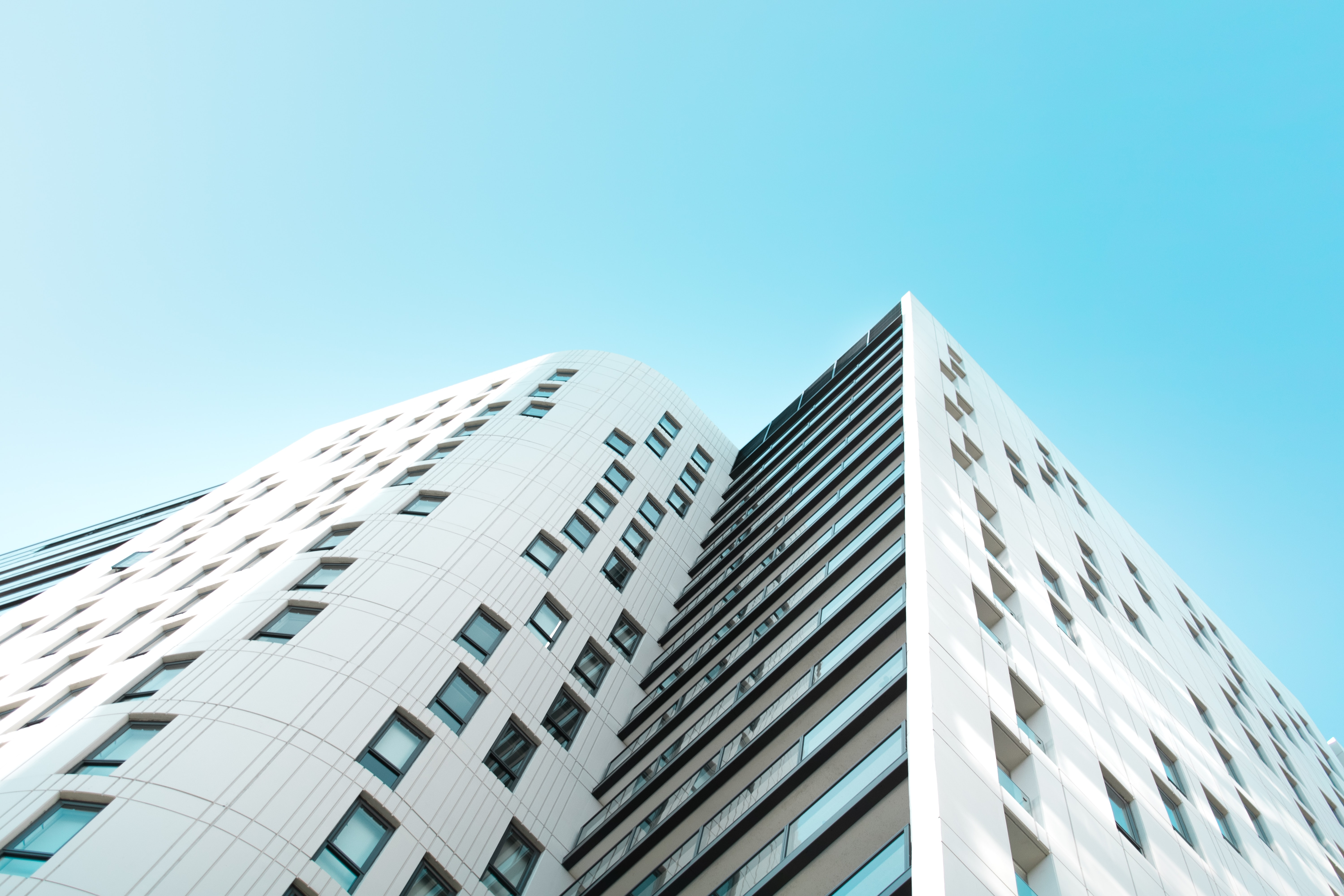 low angle photography of white concrete building