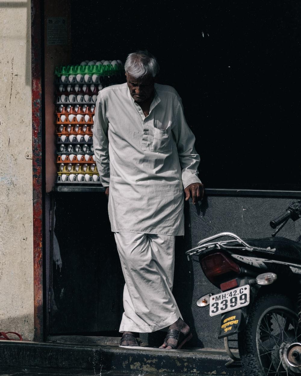 man standing near motorcycle