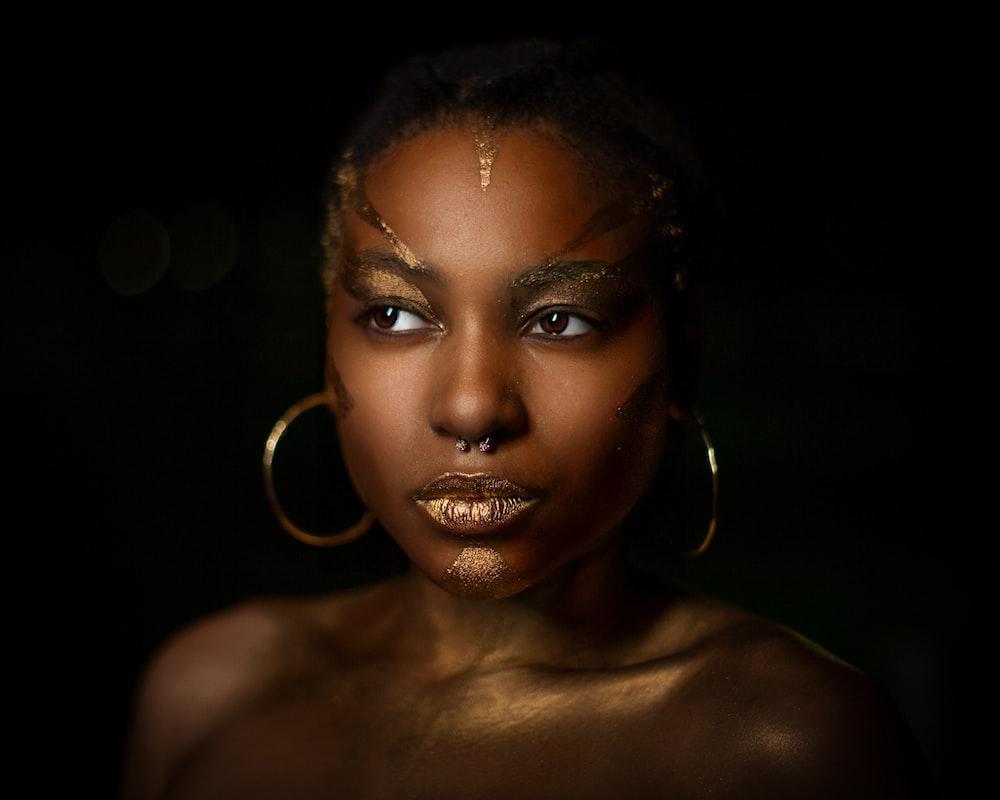 topless woman wearing hoop earrings