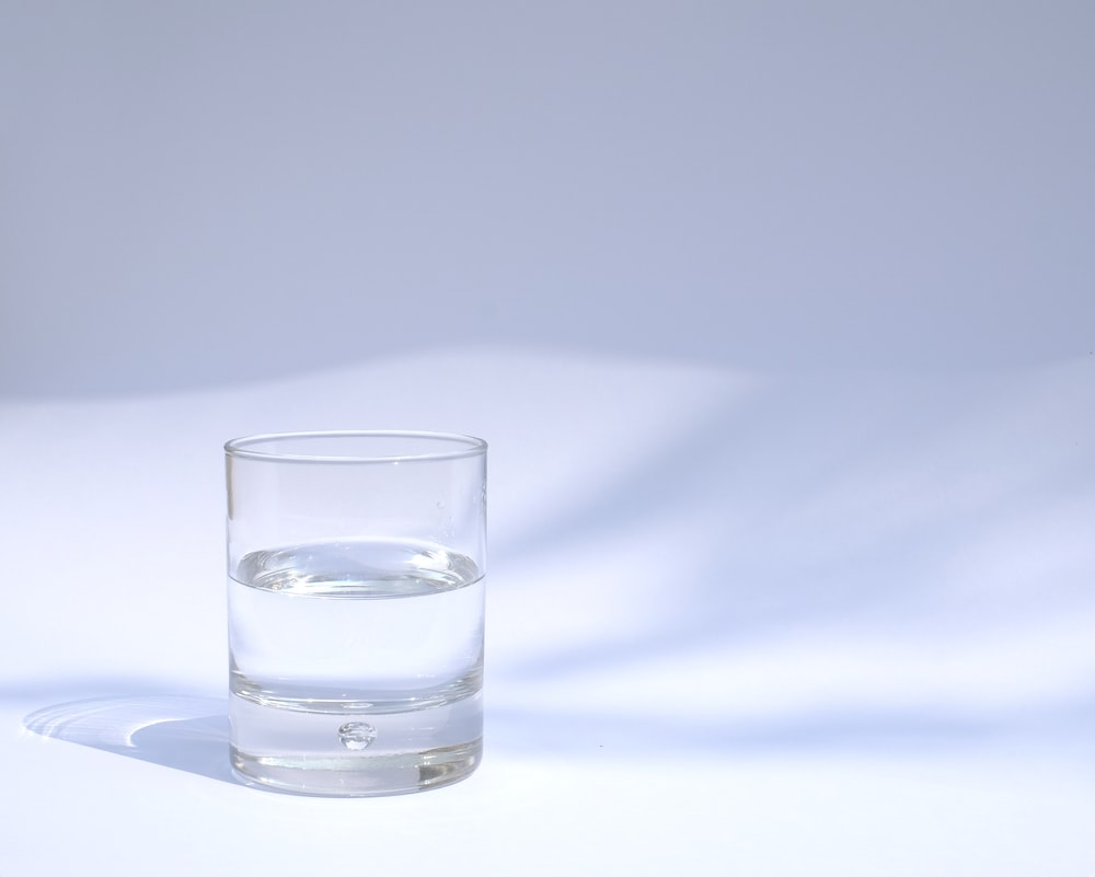 clear drinking glass filled with water