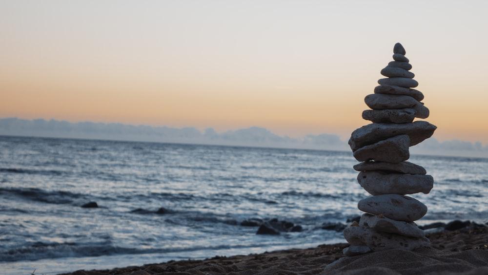 pile of white rocks on the seashore