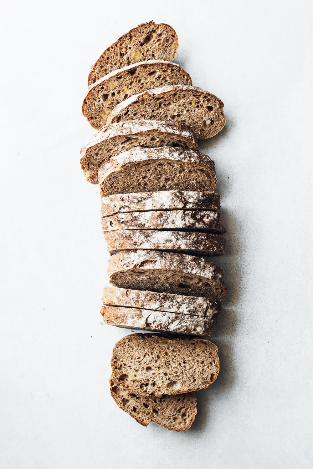 sliced breads on white surface