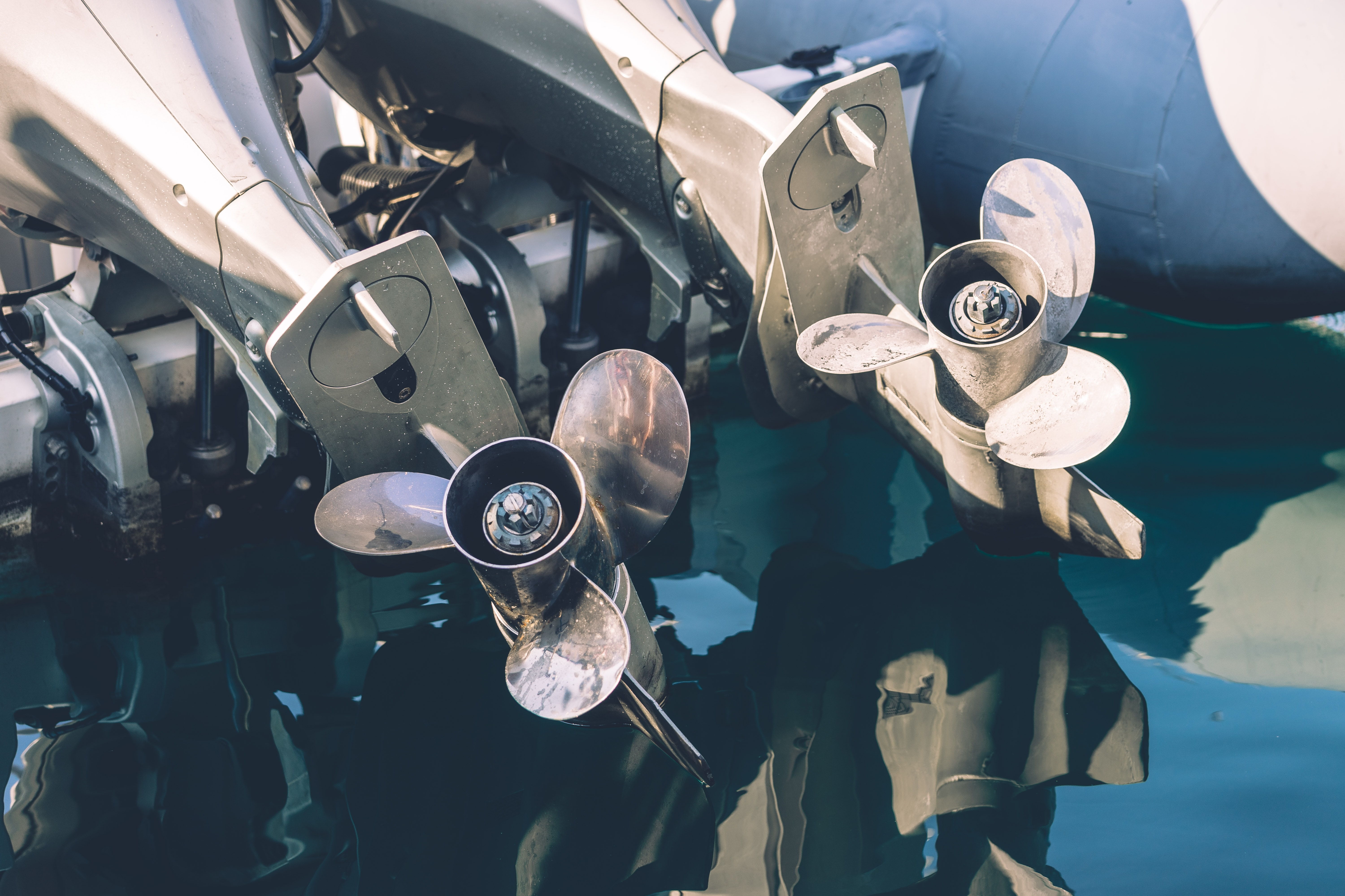 two gray propellers near body of water