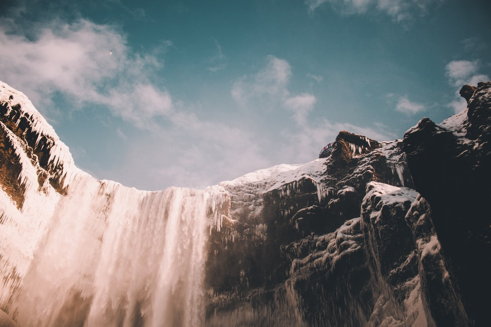 low angle photo of waterfalls at daytime