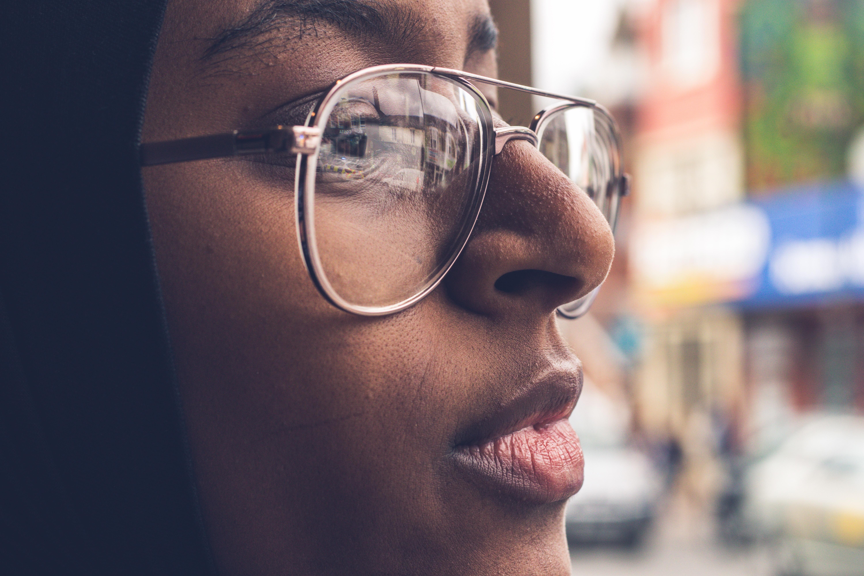 woman wearing gold framed eyeglasses during daytime