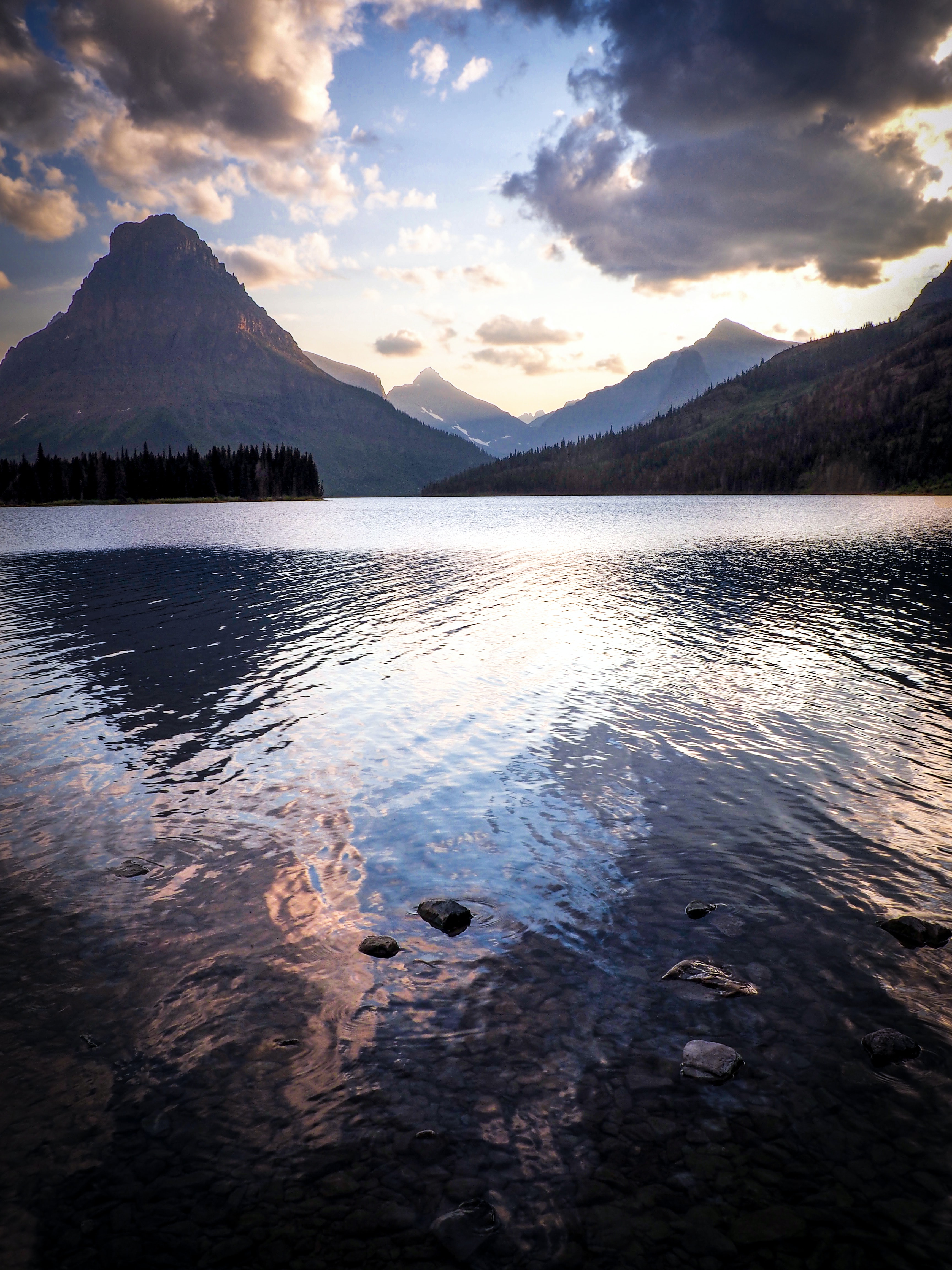 landscape photo of body of water surrounded by mountains