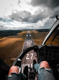 person sitting on plane dashboard