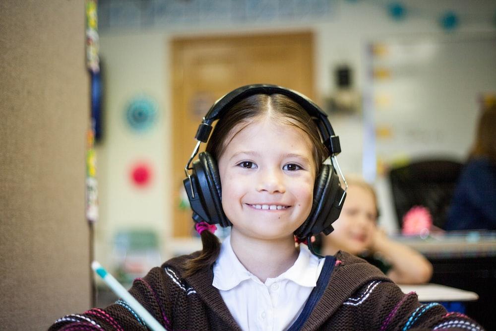 girl wearing black headphones