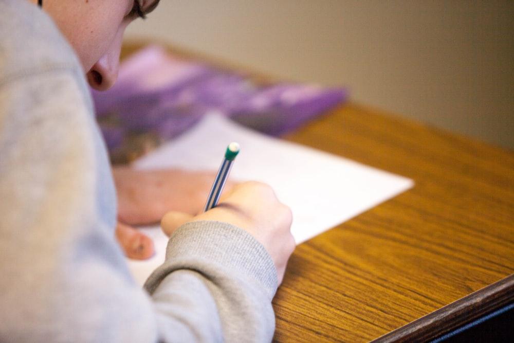 person using pencil
