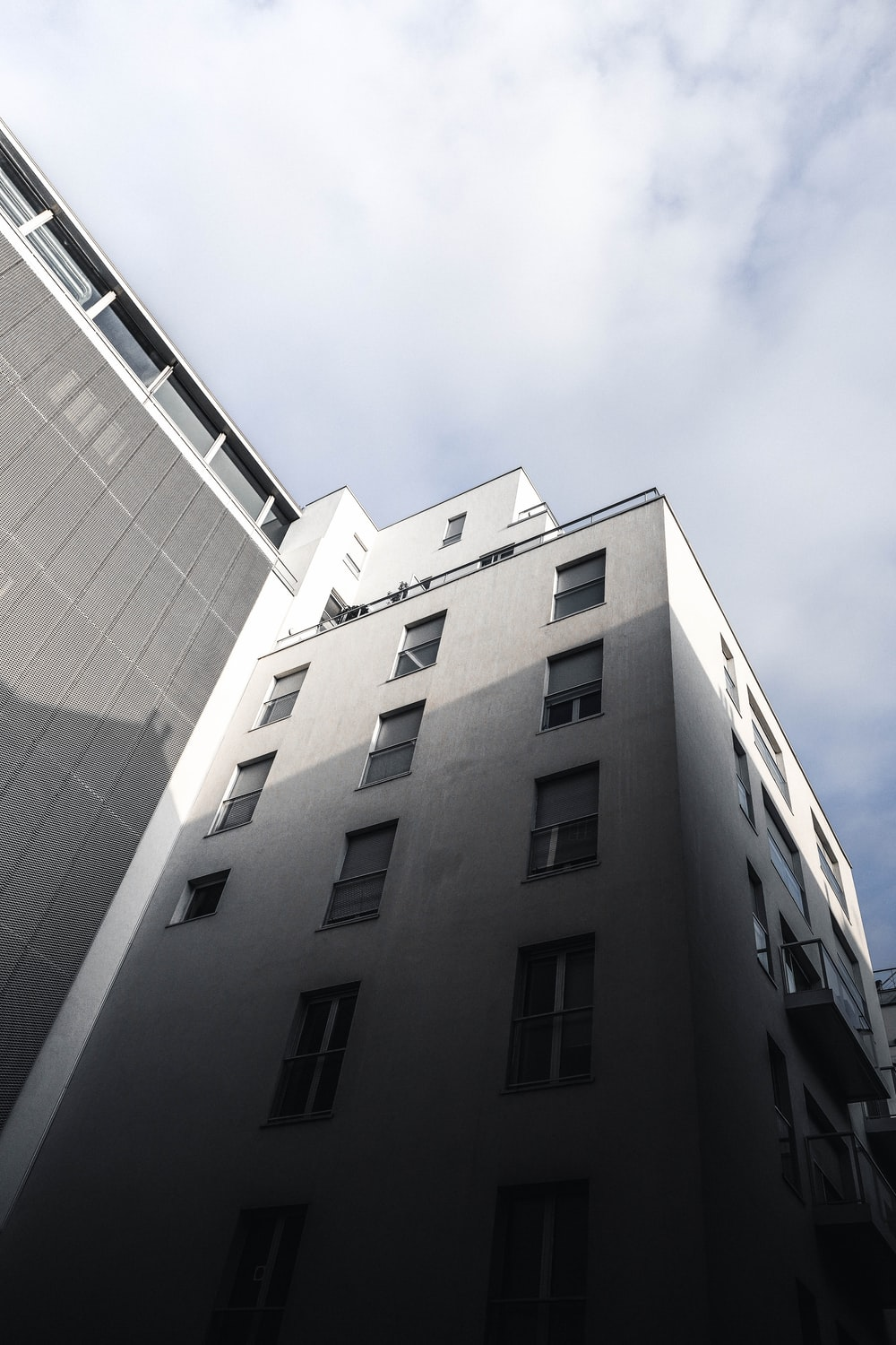 white building under cloudy sky