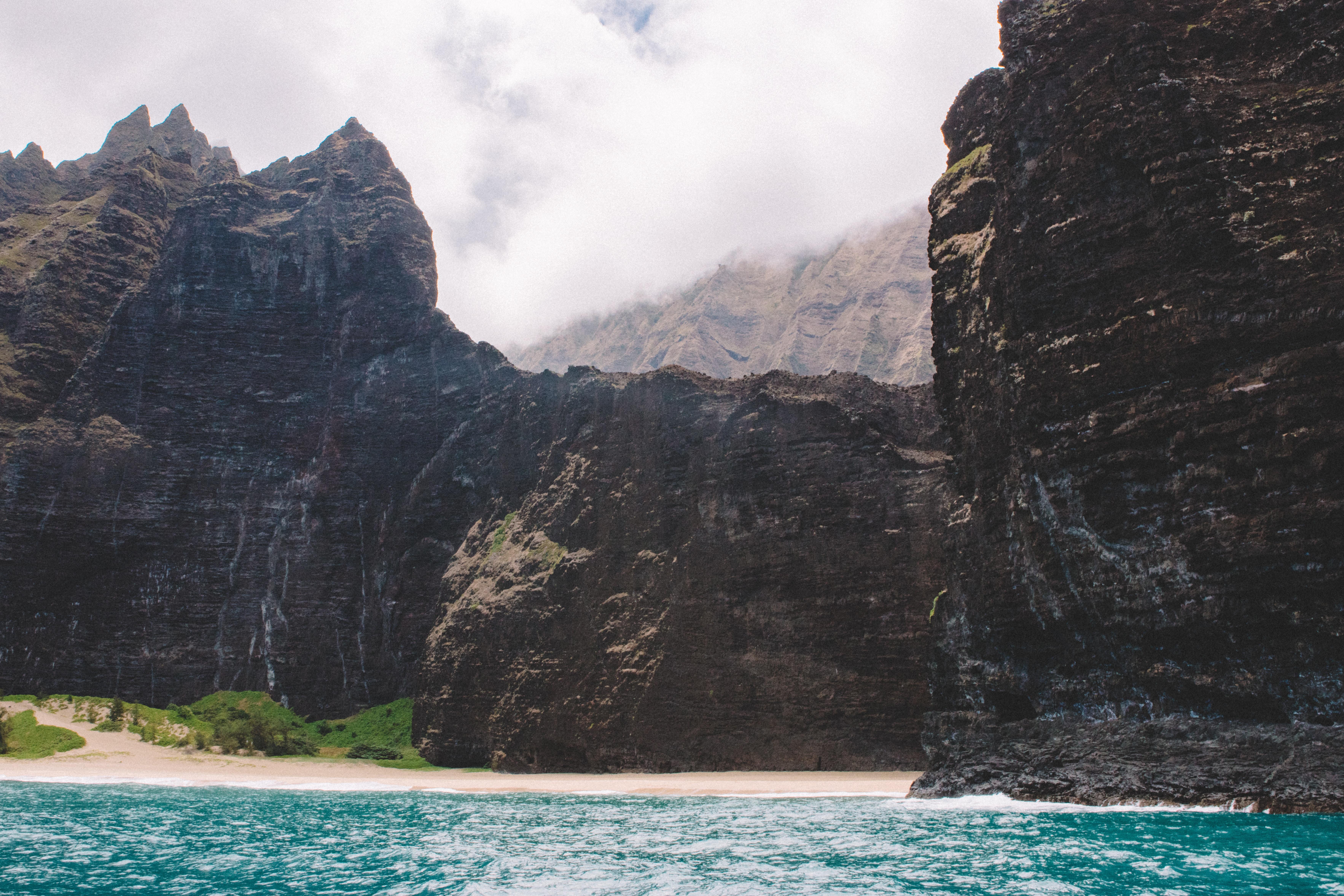 cliff beside body of water