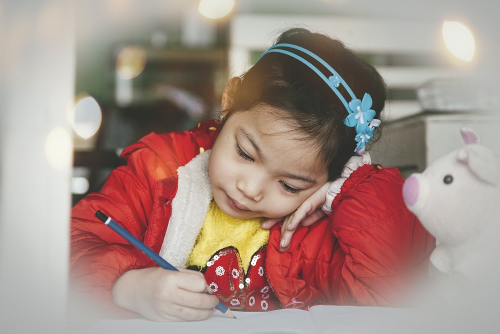 girl holding pencil