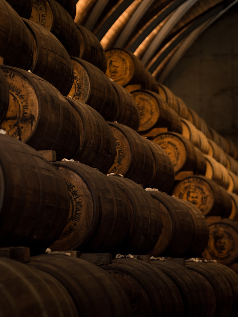 low light photography of pile of barrels