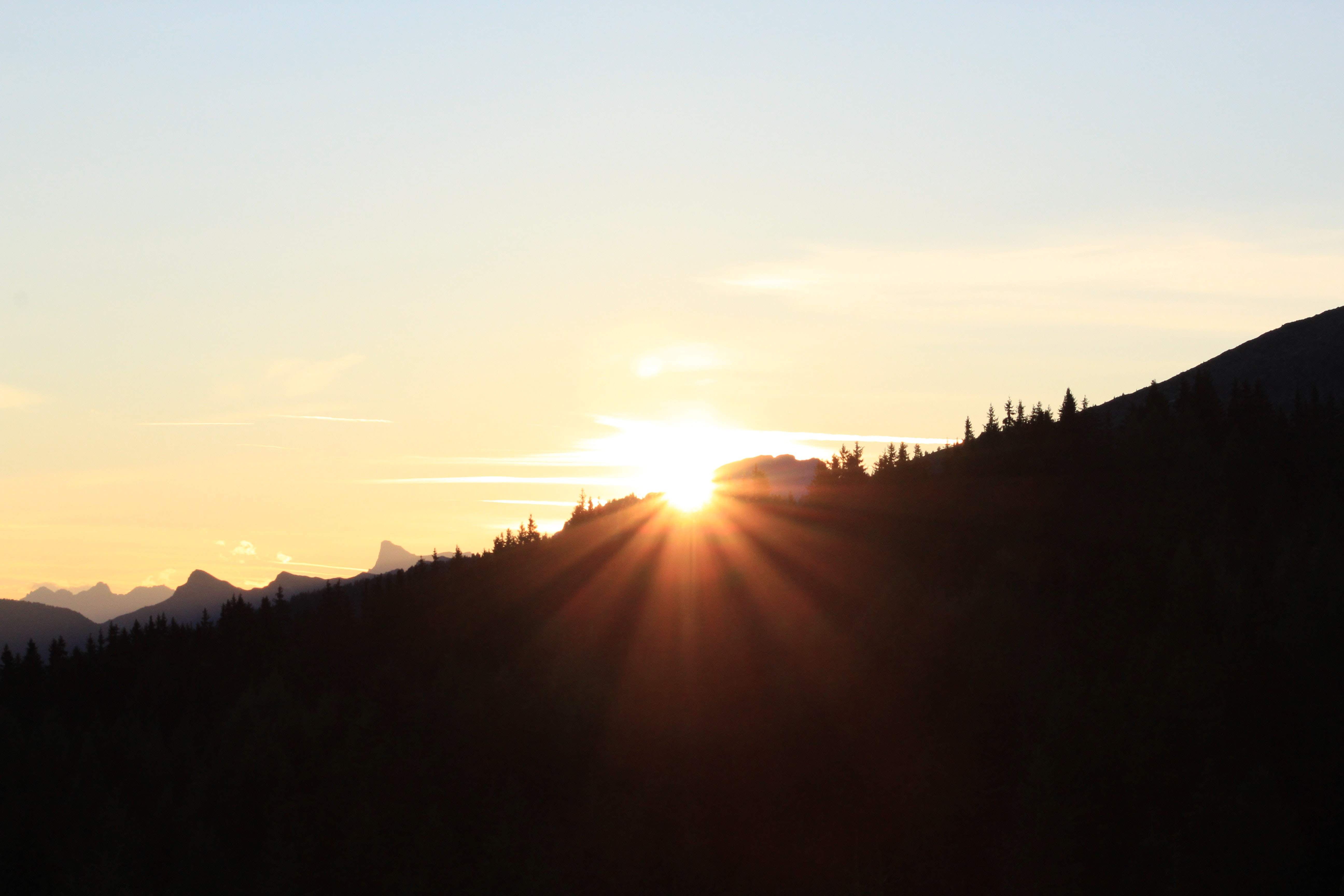 silhouette of mountain during golden hour
