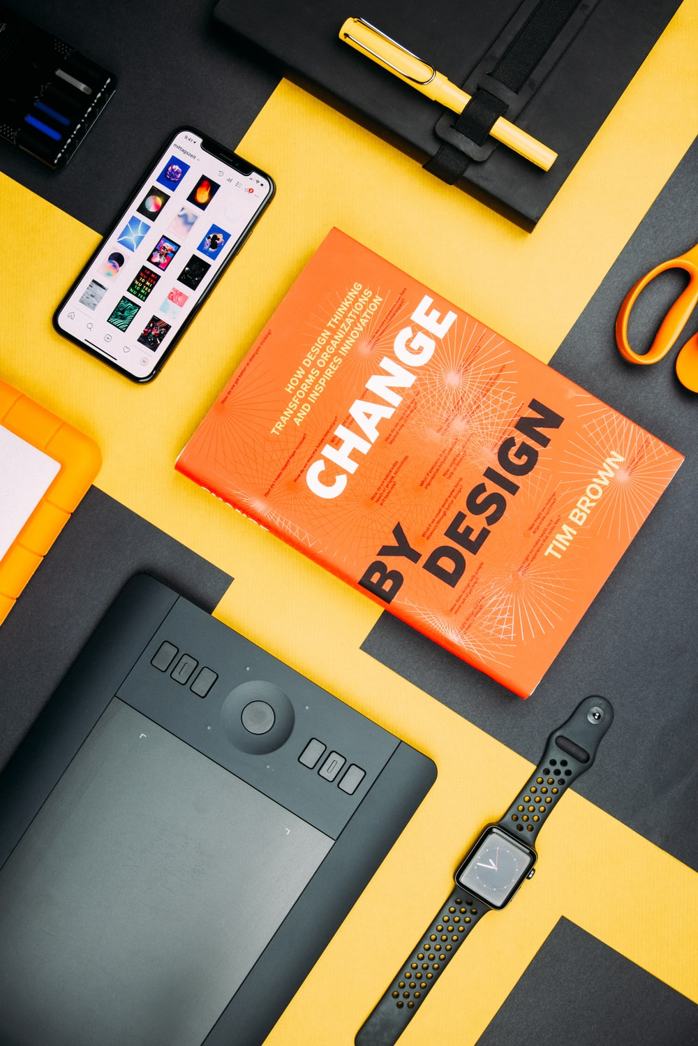 Change by Design by Tim Brown book beside smartphone