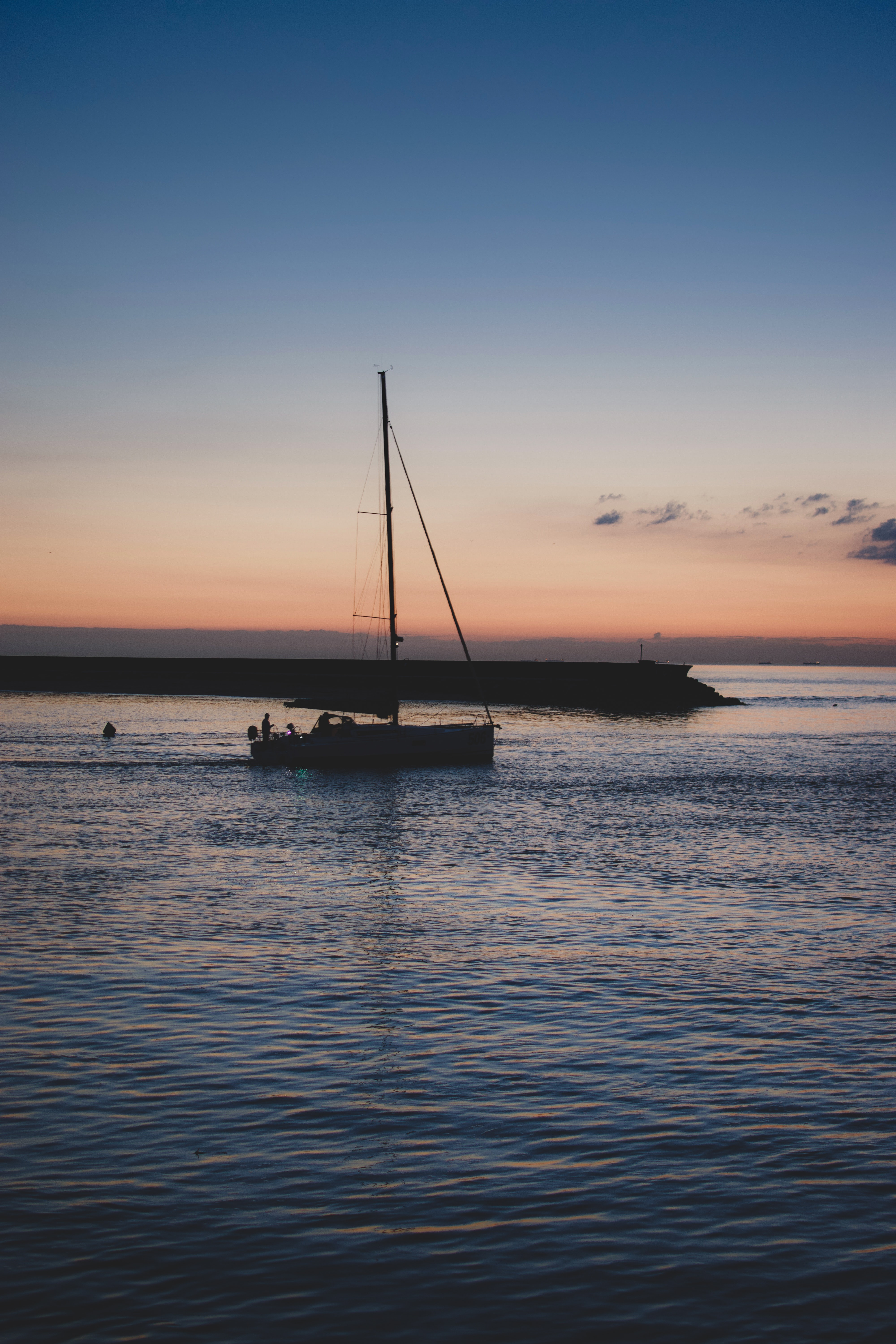 silhouette of sailboat during sunset