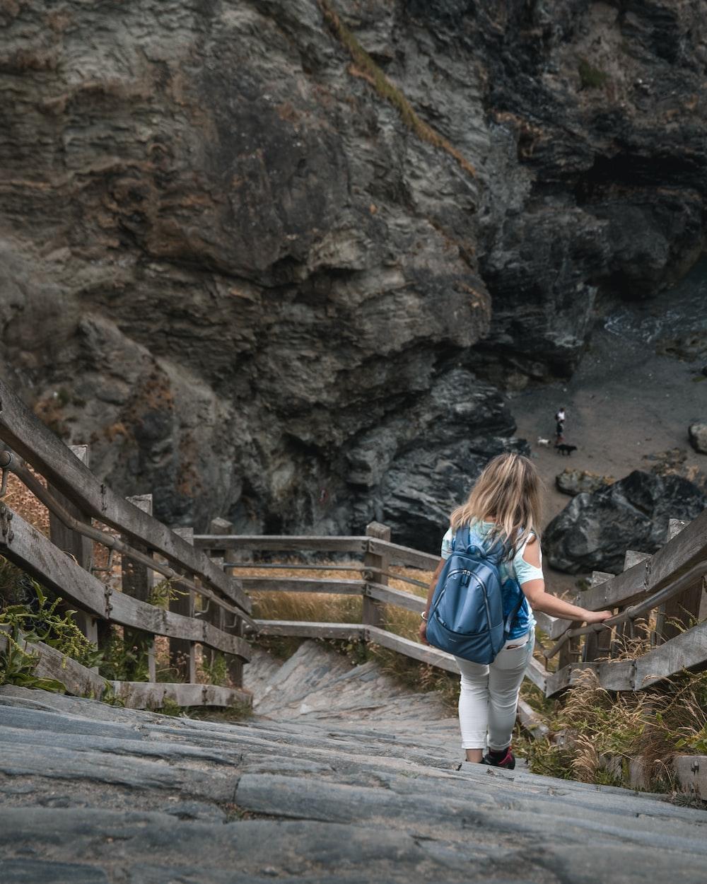 woman walking on bridge