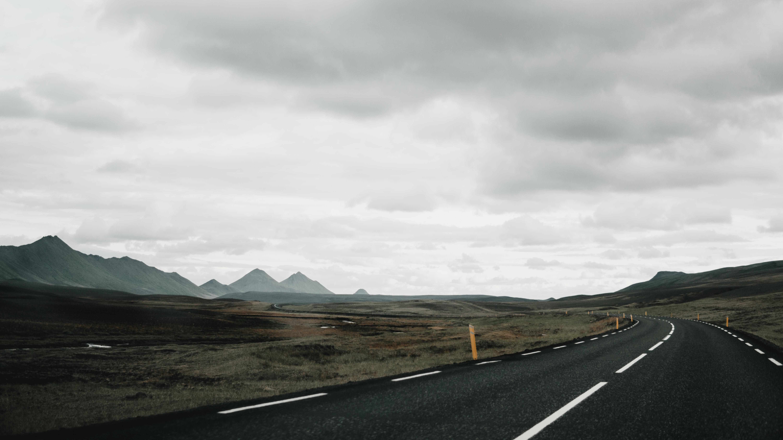 black concrete roadway during daytime