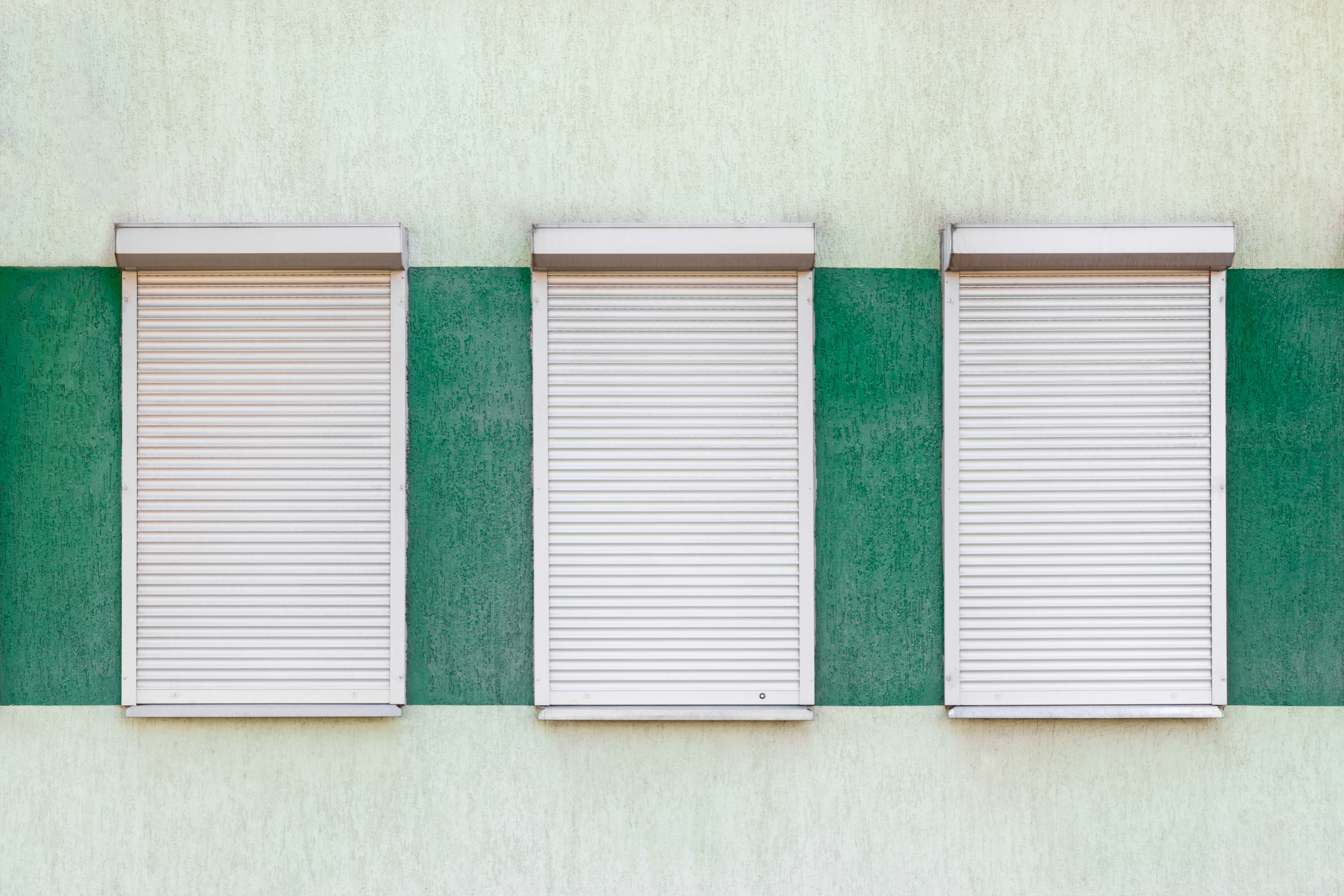three closed roller shutters