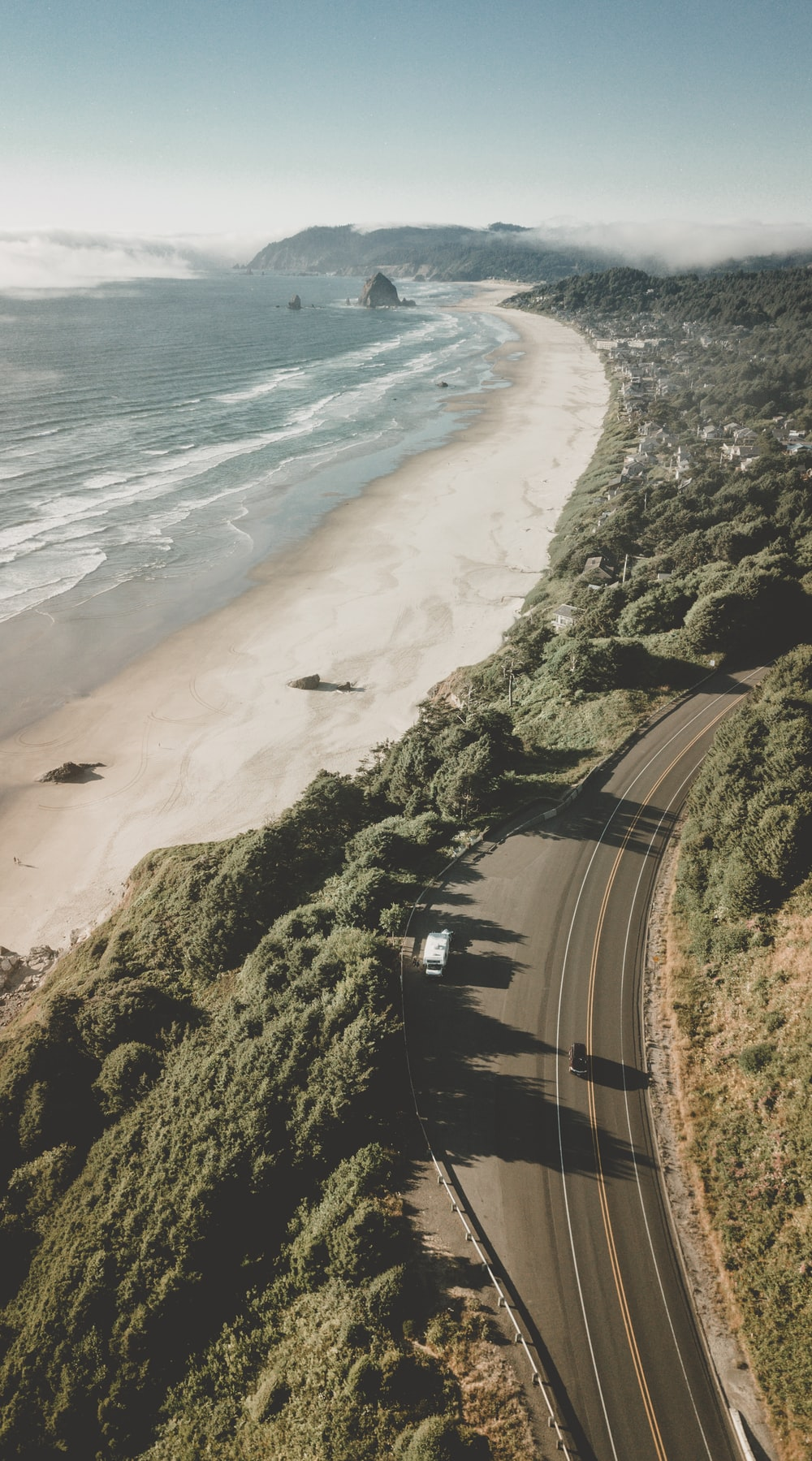 aerial photography of road near sea