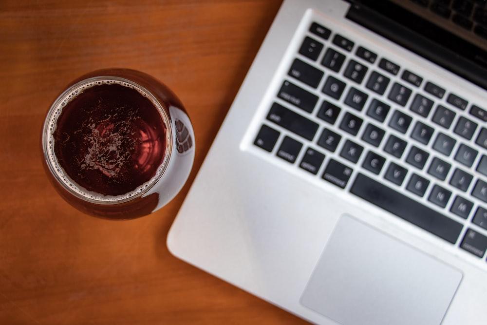 clear glass jar beside MacBook Pro