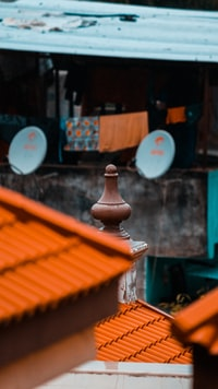 shallow focus photography of orange roof