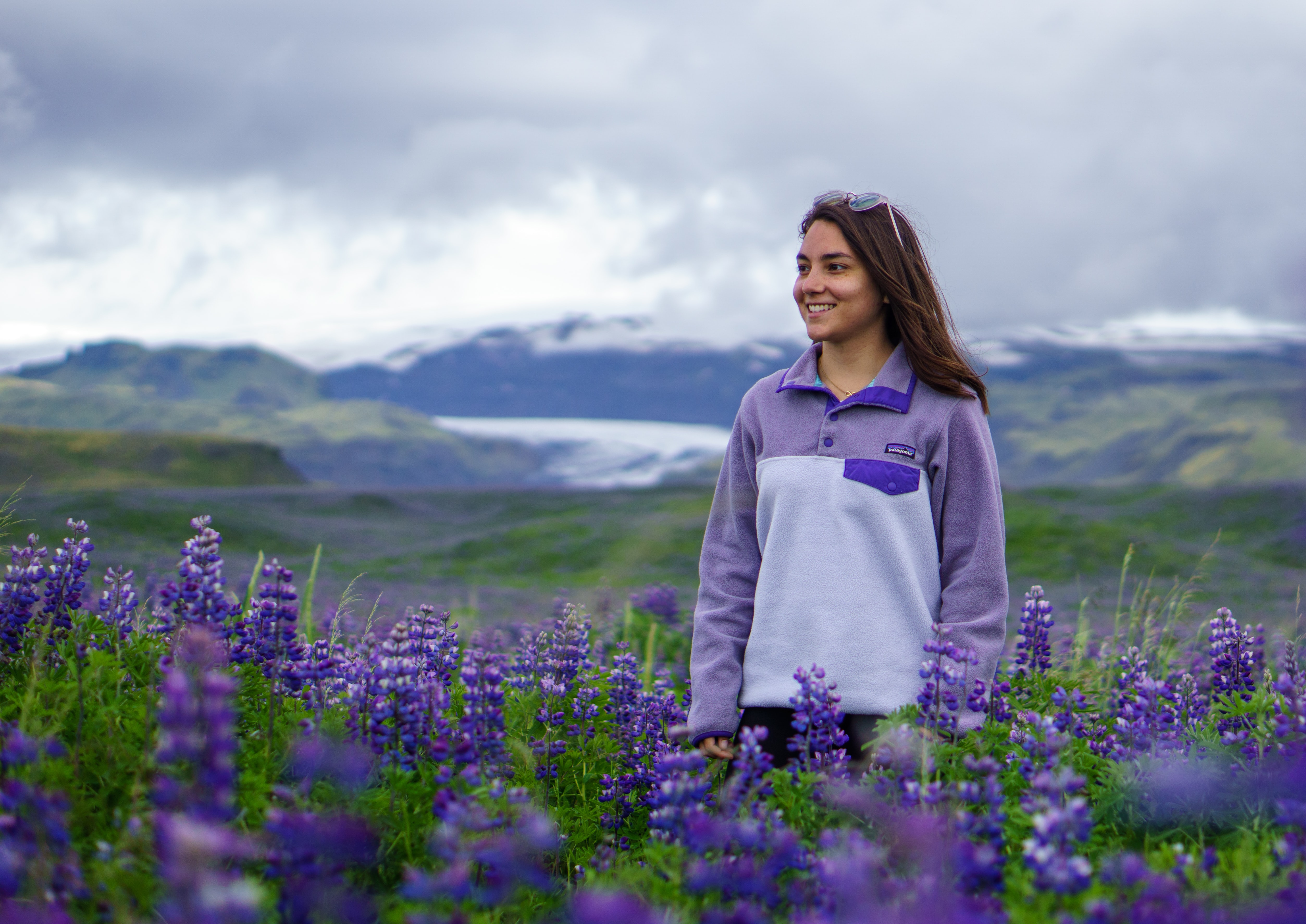 woman standing on lavender flower field during daytime