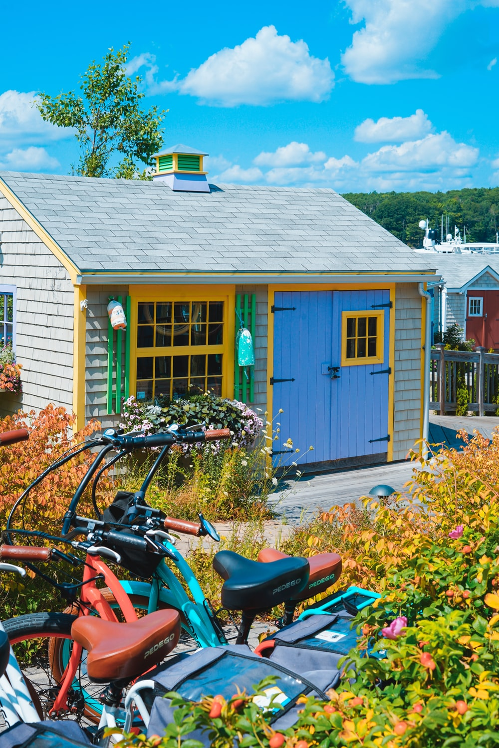 bicycles parked near blue and gray house during daytime