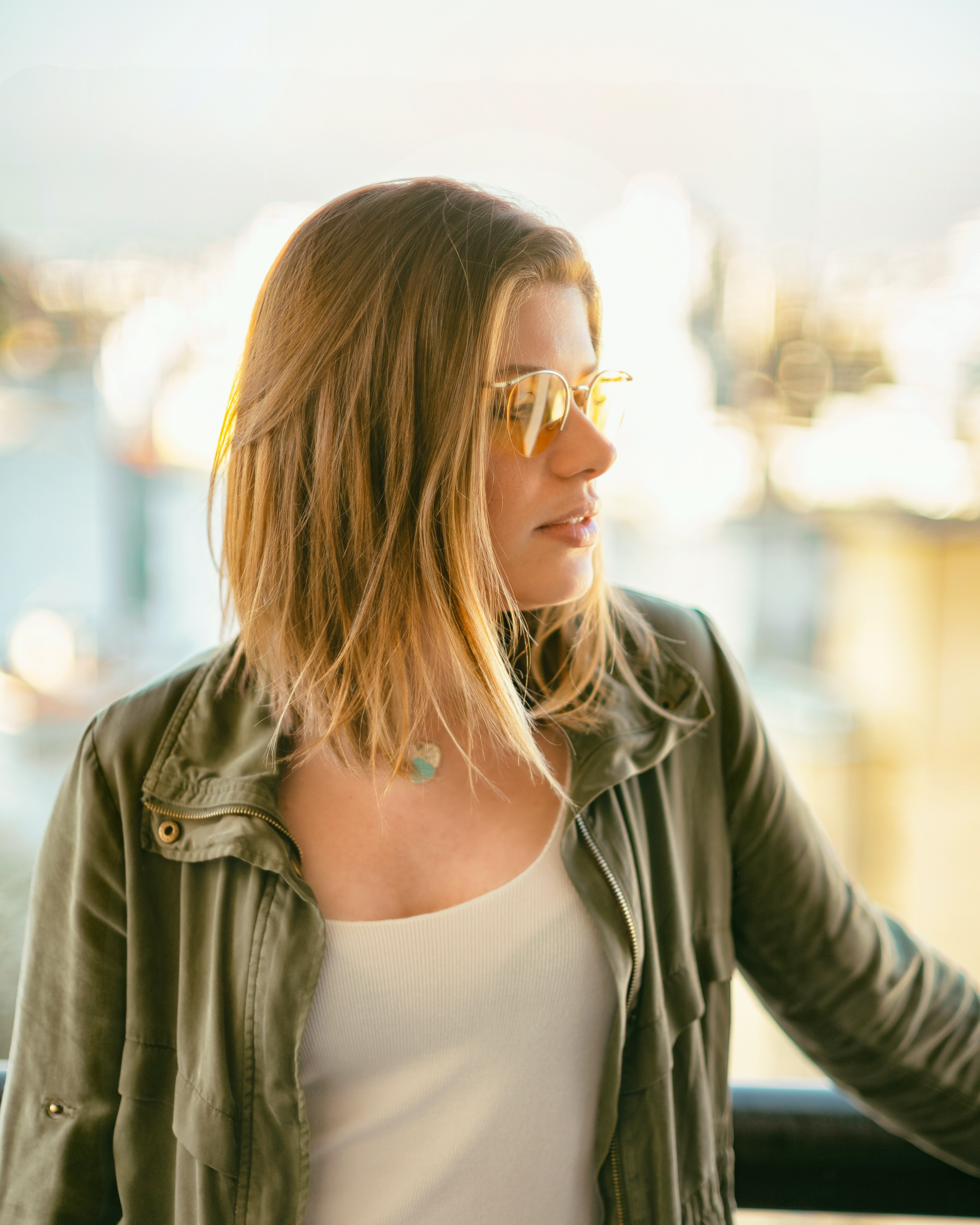 selective focus photography of woman wearing long-sleeved shirt and sunglasses