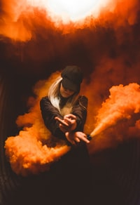 woman on black suit posing with white smoke background