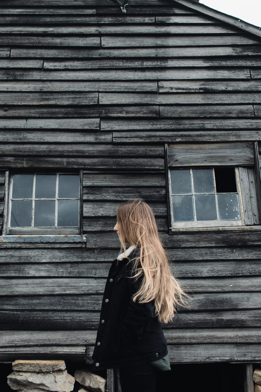 woman standing near cabin