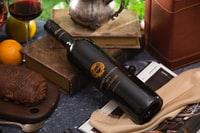 black wine glass bottle on book