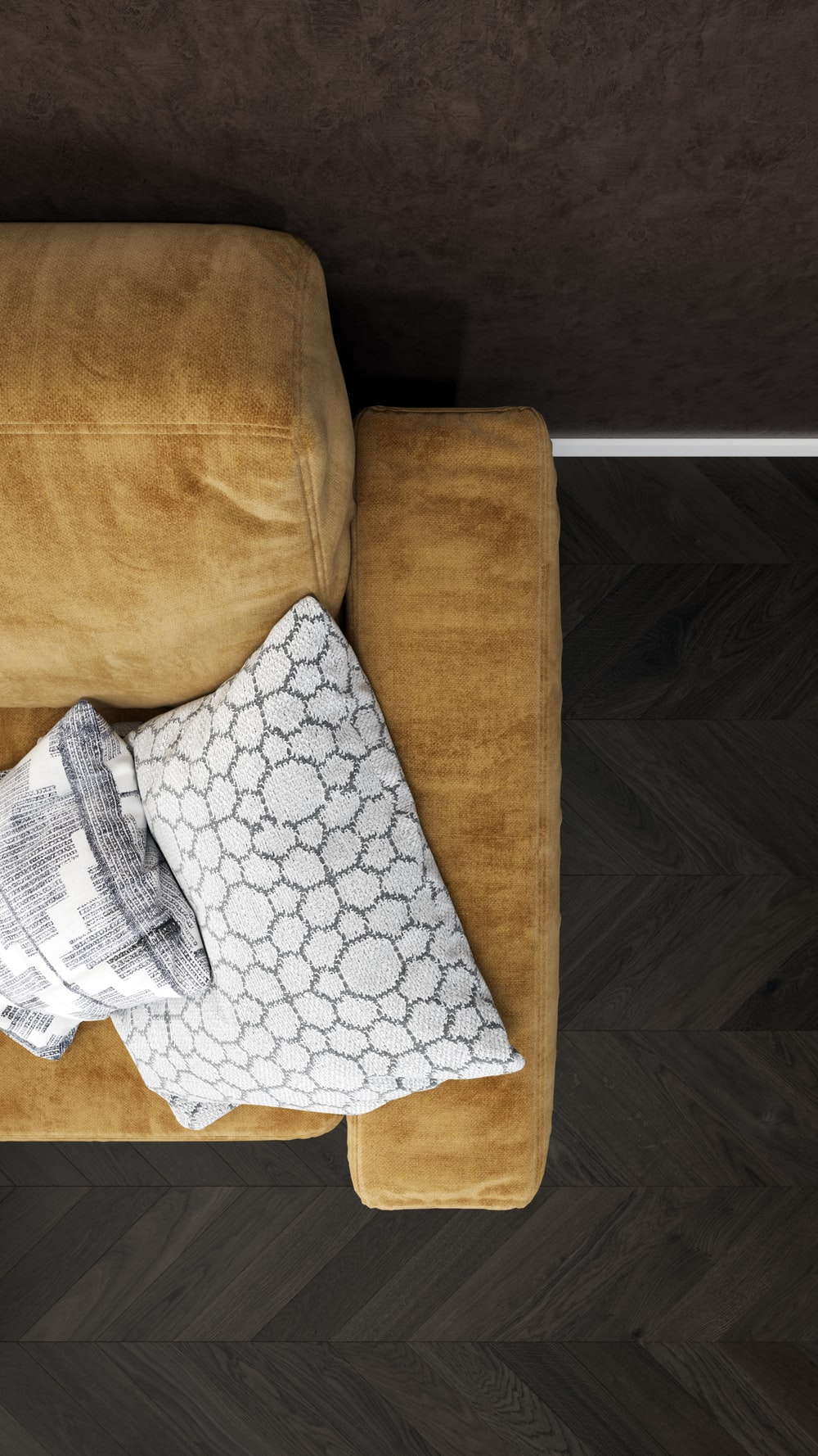two gray throw pillows on brown sofa