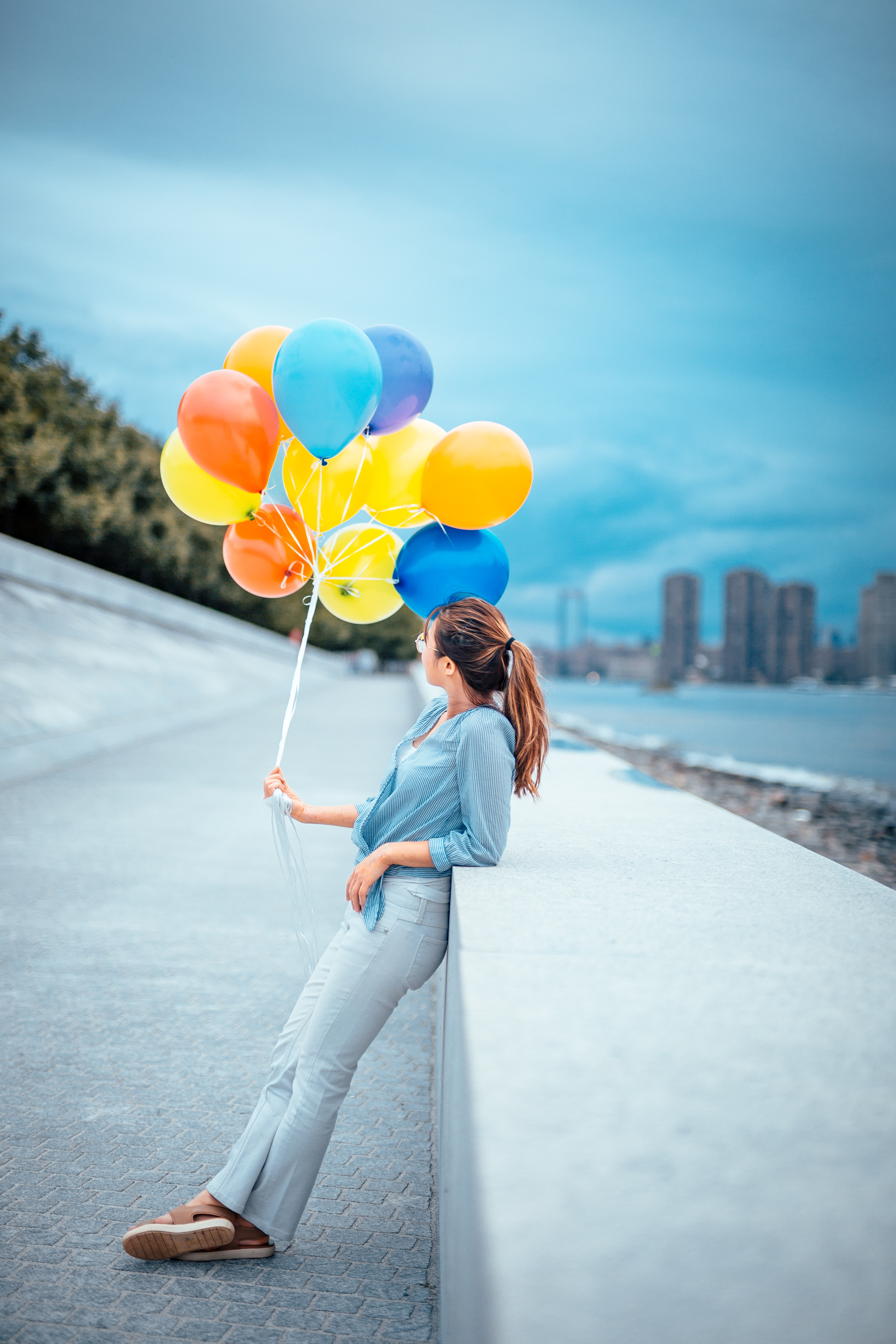 woman holding balloon lot