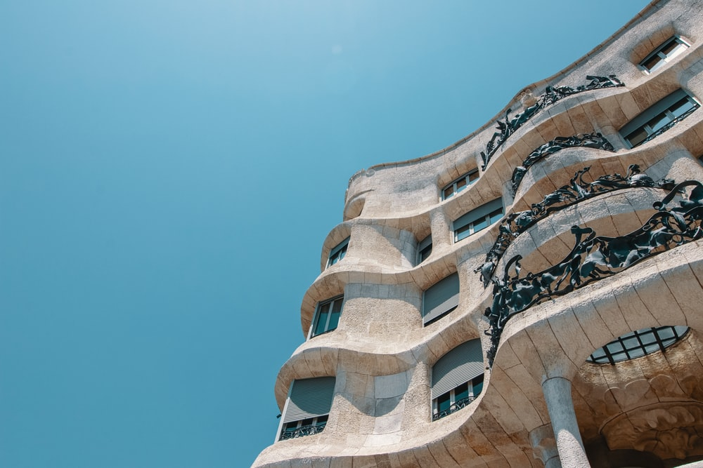 low-angle photography of beige concrete building