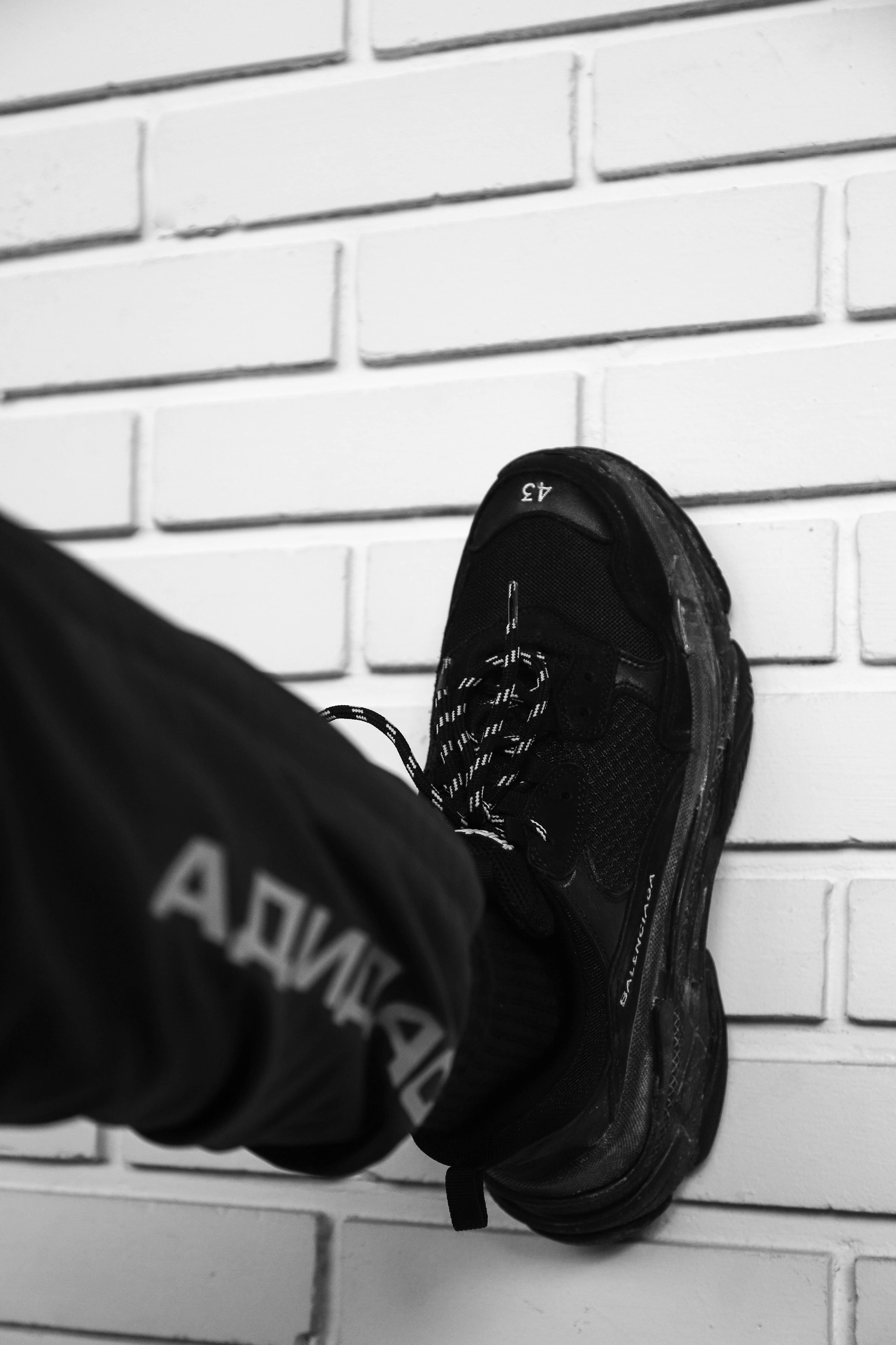 person wearing black Nike Vapor Max shoe