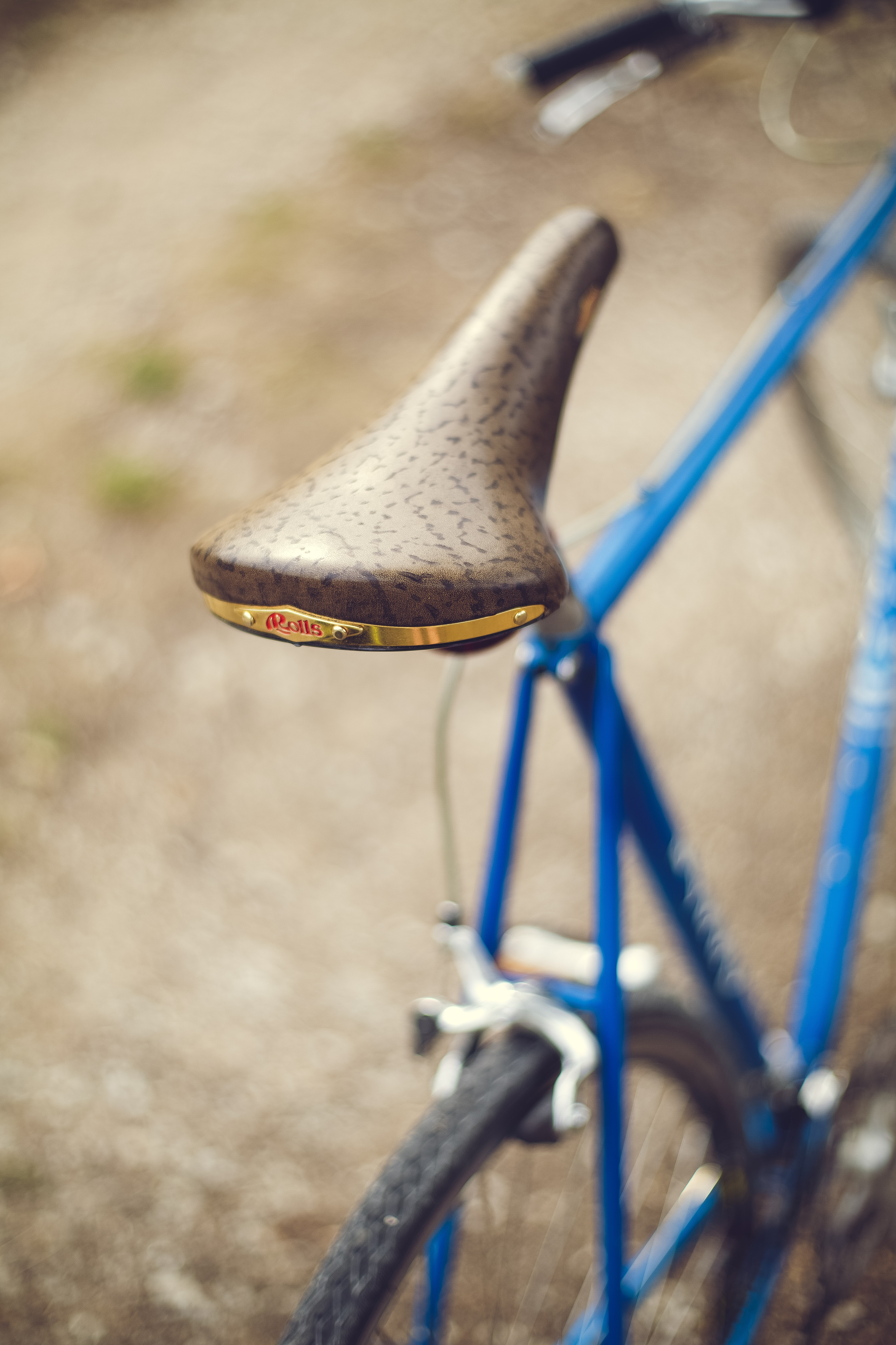 selective focus photography of gray bicycle seat