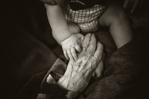 I love this photo of my mums hand reaching out to share a moment with her great grandson.  Even when we can't understand each other in language, we can all understand what a simple touch means.