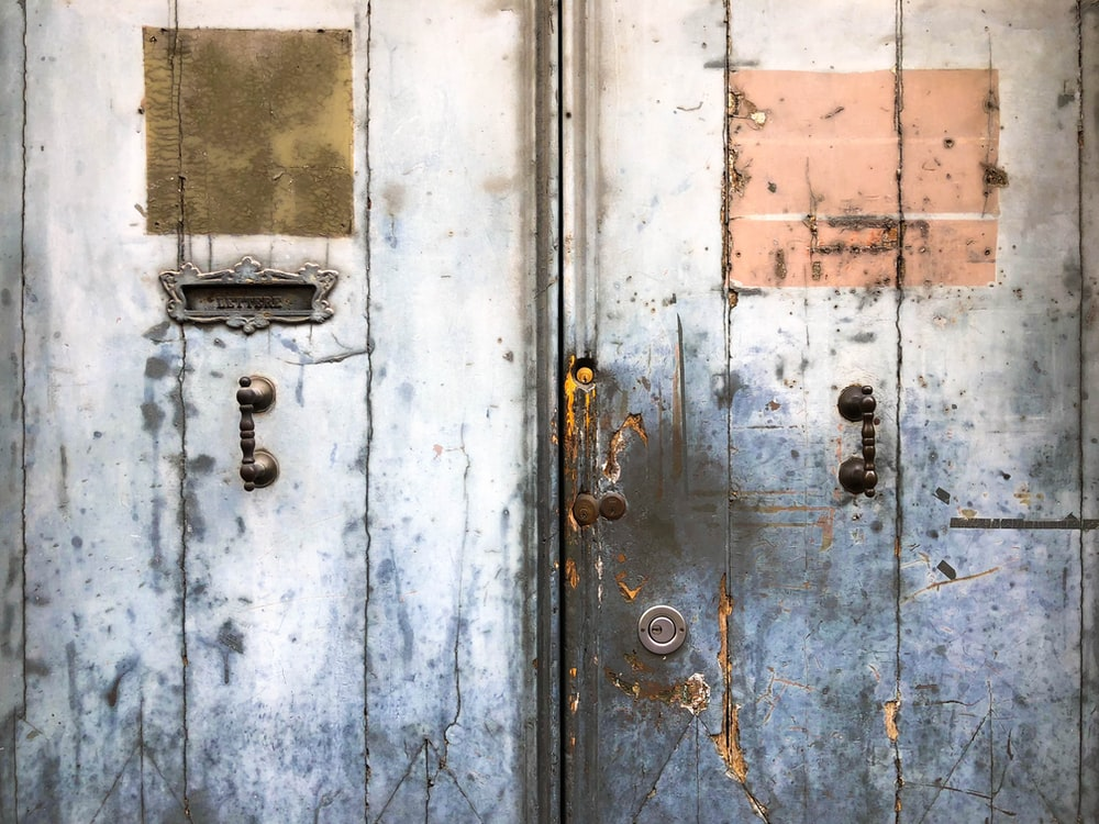closed gray wrecked door