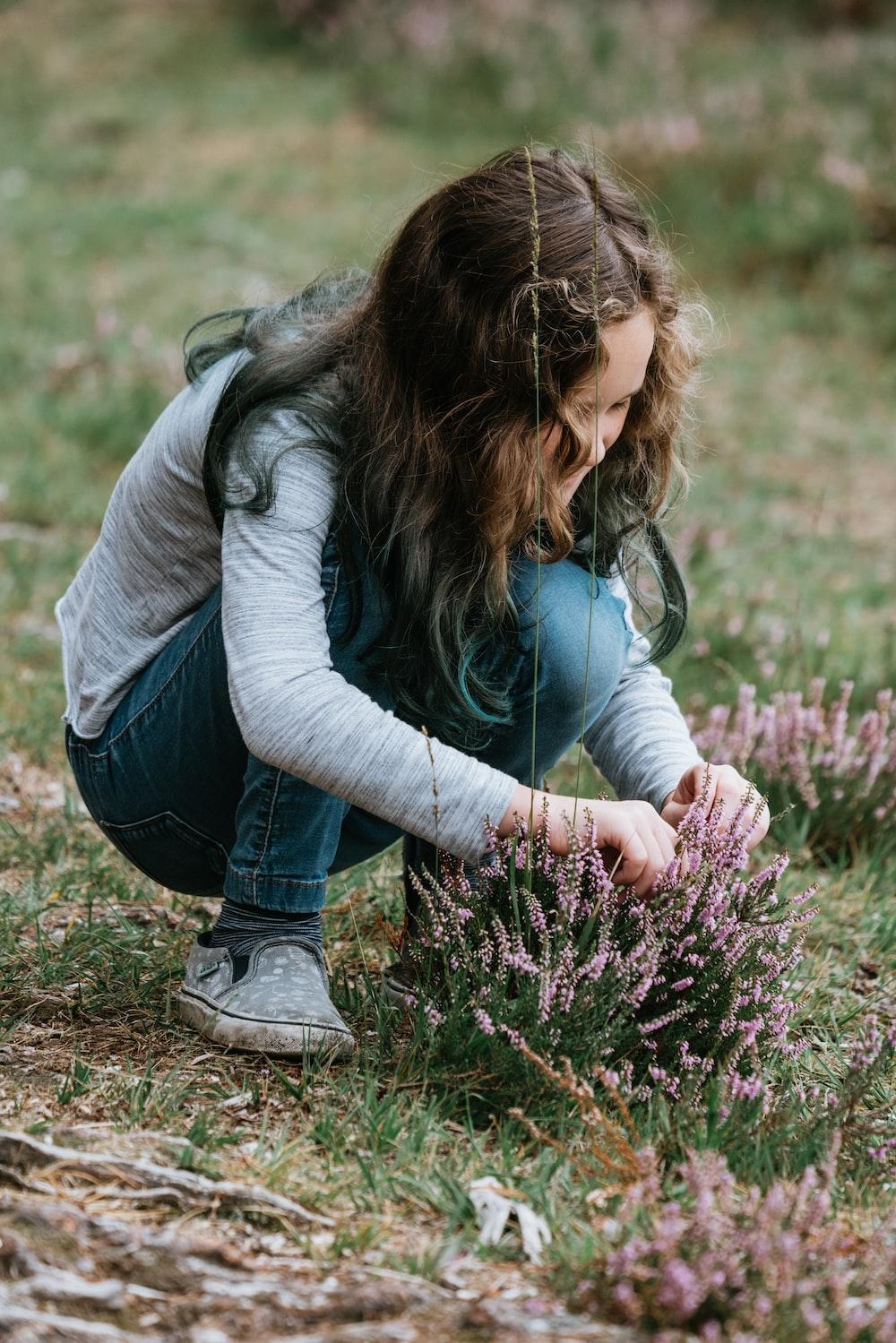woman holding purple flower