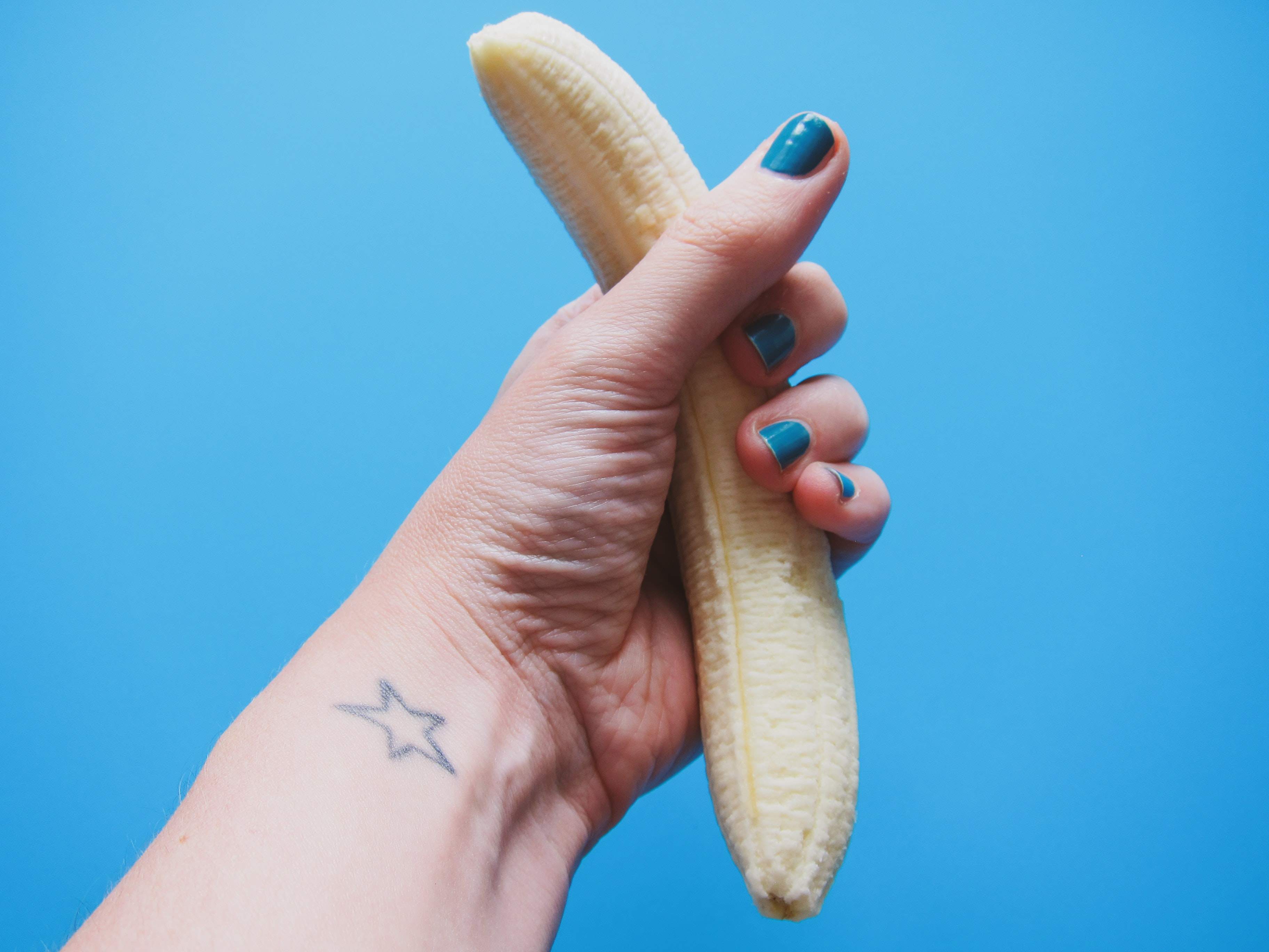 person holding peeled banana fruit